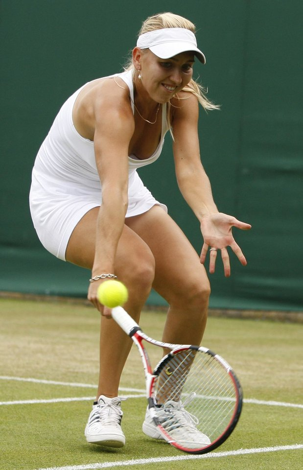 Elena Vesnina of Russia returns to Dominika Cibulkova of Slovakia, during their third round singles match at Wimbledon, Friday, June 26, 2009. (AP Photo/Kirsty Wigglesworth)  ORG XMIT: XWIM172