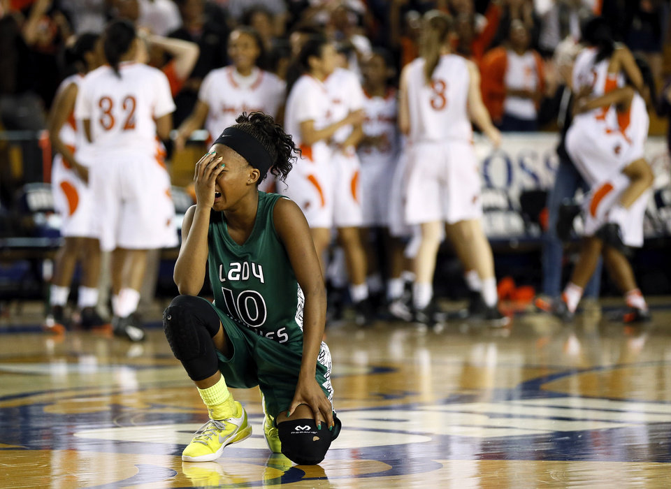 Photo - Edmond Santa Fe's Cameerah Graves (10) reacts after Santa Fe lost to Booker T. Washington in a Class 6A girls high school basketball game in the semifinals of the state tournament at the Mabee Center in Tulsa, Okla., Friday, March 8, 2013. Bookter T. Washington won, 72-70. Photo by Nate Billings, The Oklahoman