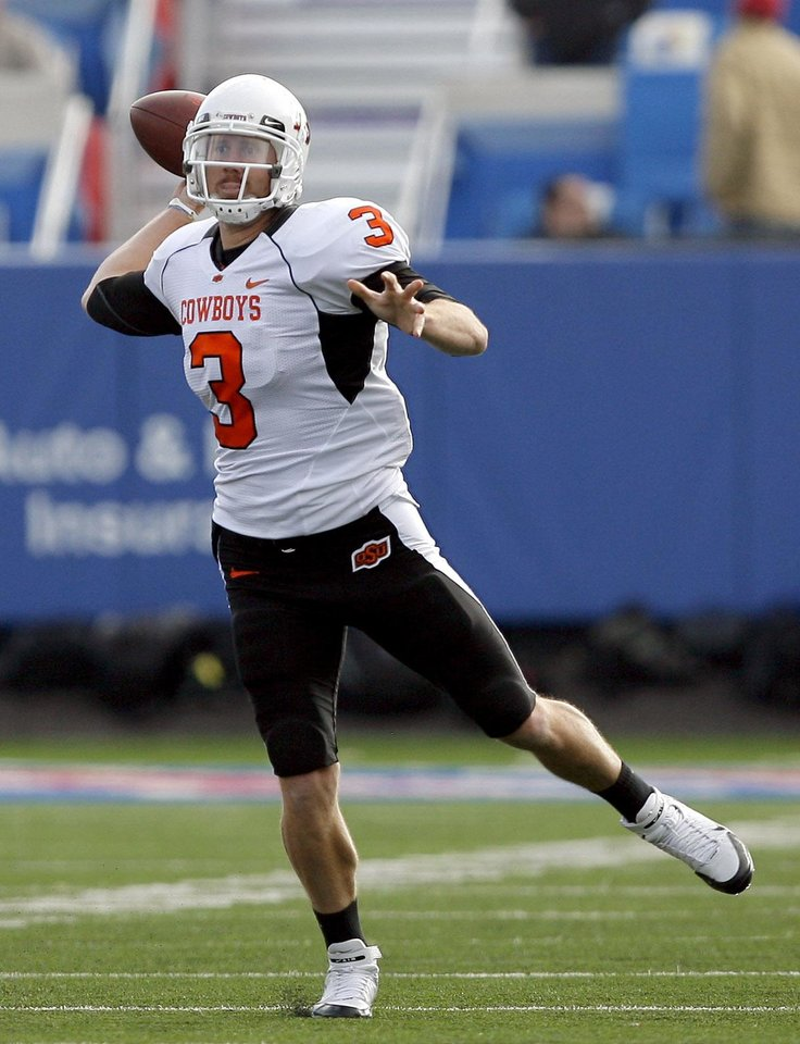Photo - Oklahoma State Brandon Weeden (3) throws a pass during the college football game between Oklahoma State (OSU) and Kansas (KU), Saturday, Nov. 20, 2010 at Memorial Stadium in Lawrence, Kan. Photo by Sarah Phipps, The Oklahoman