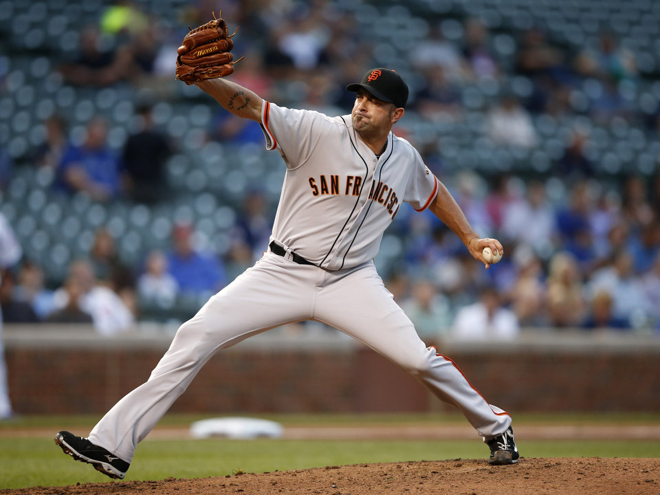 Photo - San Francisco Giants relief pitcher Jeremy Affeldt delivers against the Chicago Cubs during the eighth inning of the continuation of a rain-suspended baseball game that began Tuesday, on Thursday, Aug. 21, 2014, in Chicago. (AP Photo/Andrew A. Nelles)