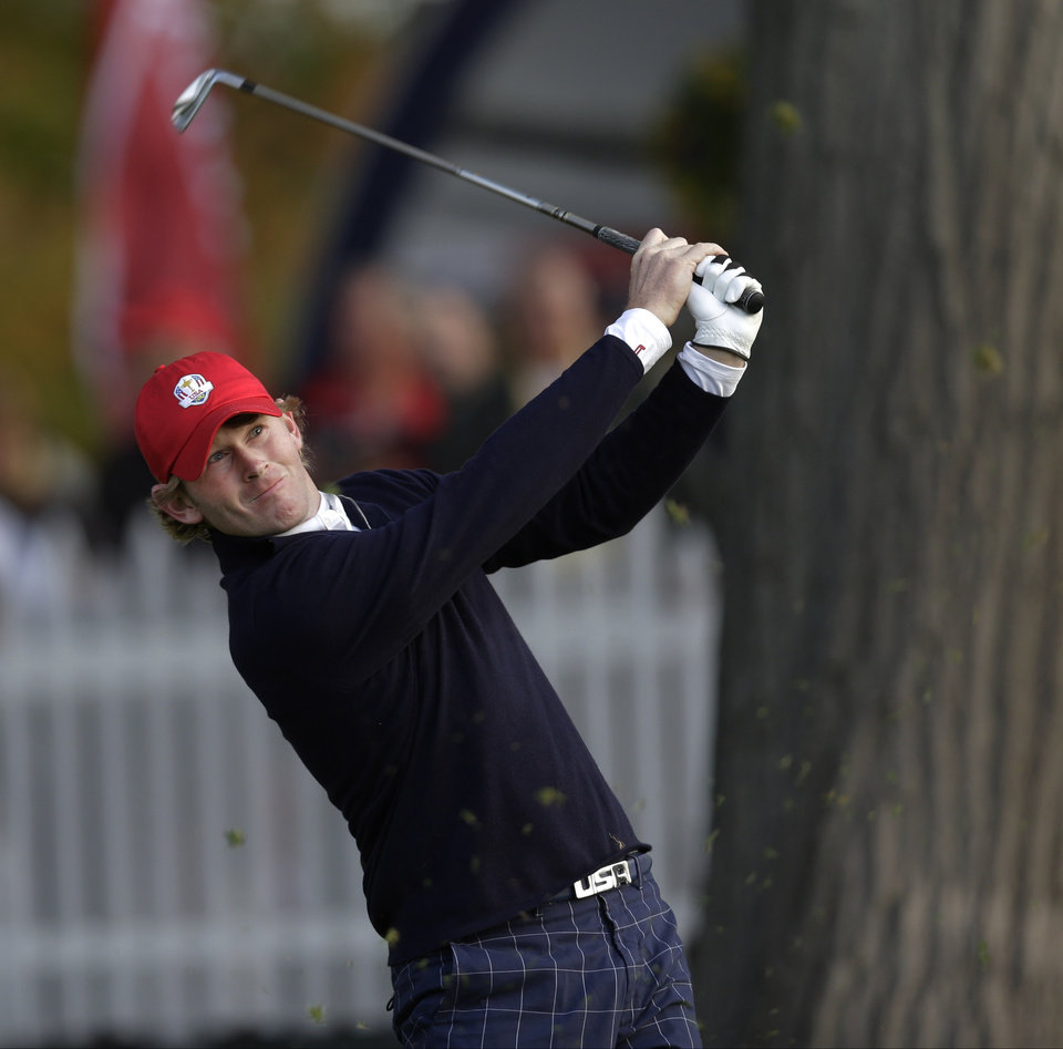 Photo -   USA's Brandt Snedeker hits a sot on the second hole during a foursomes match at the Ryder Cup PGA golf tournament Friday, Sept. 28, 2012, at the Medinah Country Club in Medinah, Ill. (AP Photo/David J. Phillip)