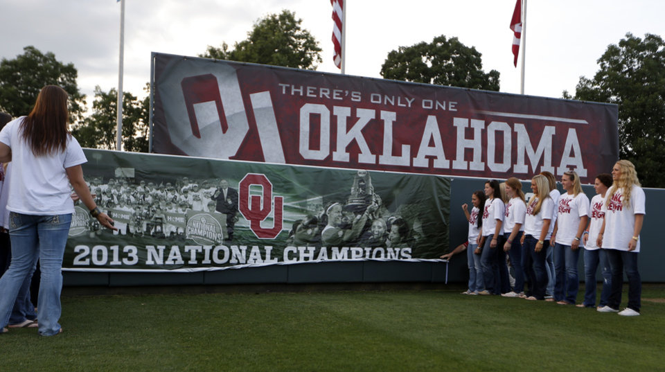 Photo - Oklahoma celebrate their Women's College World Series title in Norman, Okla.,Friday, June 7, 2013. Photo by Sarah Phipps, The Oklahoman