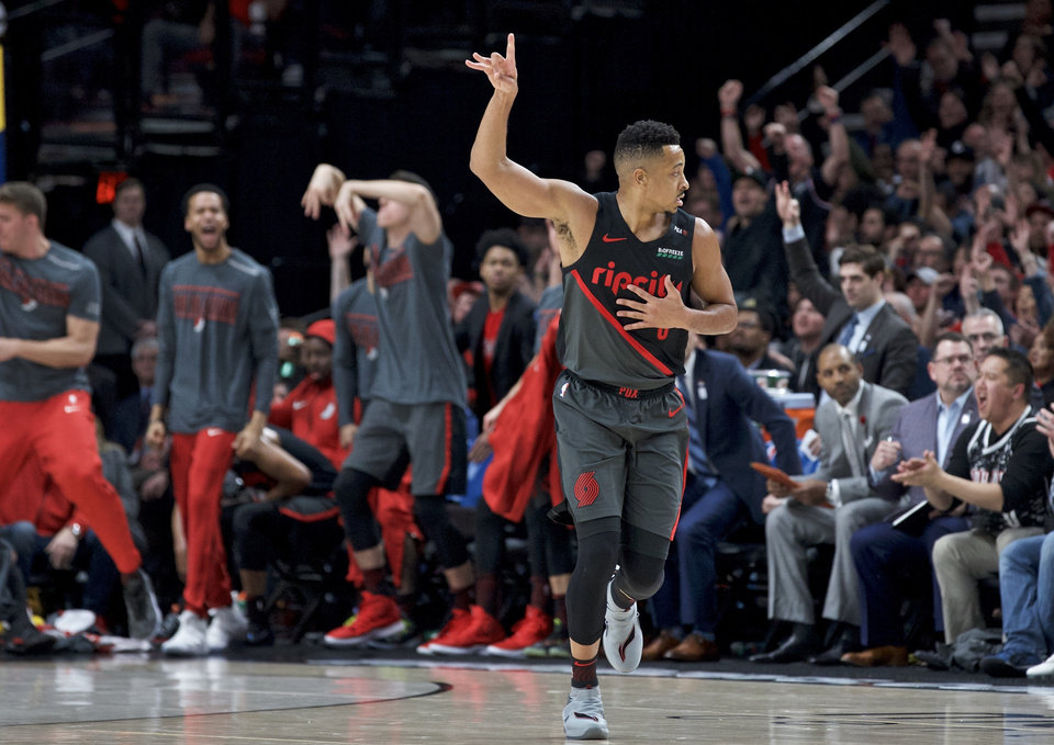 Photo - Portland Trail Blazers guard CJ McCollum reacts after making a 3-point basket against the Oklahoma City Thunder during the first half of an NBA basketball game in Portland, Ore., Thursday, March 7, 2019. (AP Photo/Craig Mitchelldyer)