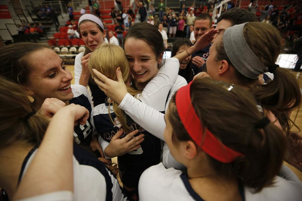 Moly Coen (15) hugs Carly Newell (3) after winning the OSSAA 5A State Volleyball Championship between Cascia Hall and Heritage Hall at Westmoore High School in Moore, Okla., Saturday, Oct. 13, 2012.  Photo by Garett Fisbeck, The Oklahoman