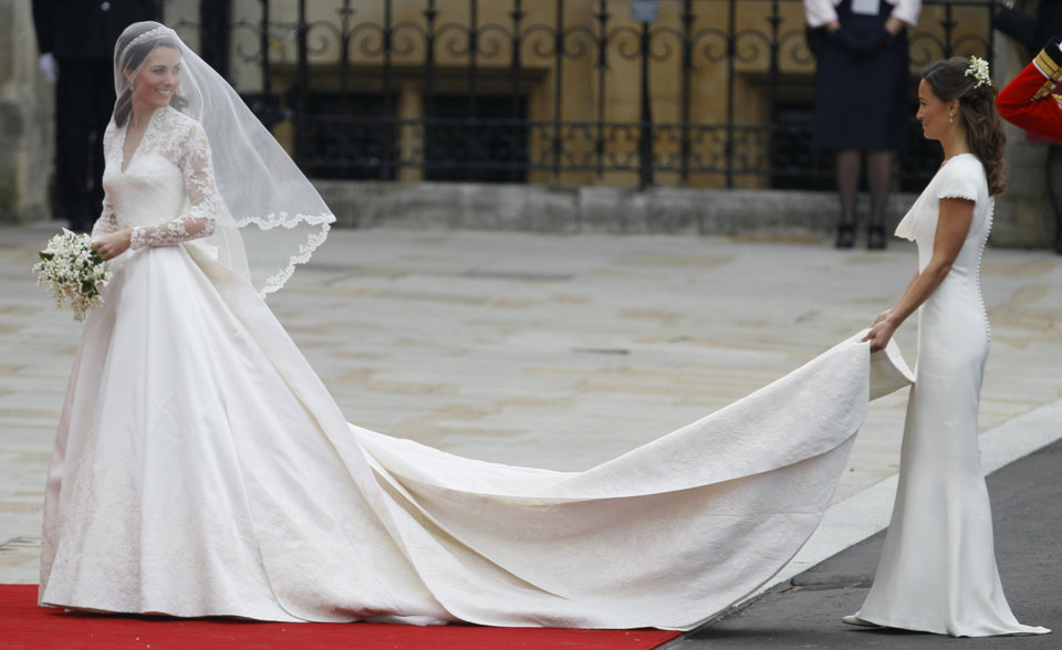 Photo - Kate Middleton, left, and accompanied by maid of honour Pippa Middleton  as they arrive at Westminster Abbey at the Royal Wedding in London Friday, April 29, 2011. (AP Photo/Alastair Grant)