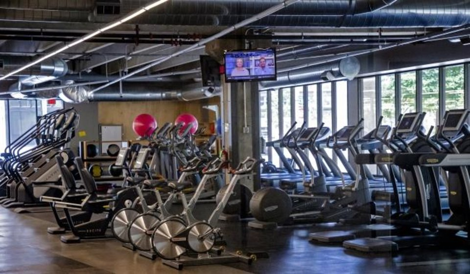 Photo -  The pending $35.5 million purchase of SandRidge tower includes workout equipment in the company's fitness center at Dean A. McGee and Broadway Ave. [CHRIS LANDSBERGER/THE OKLAHOMAN]
