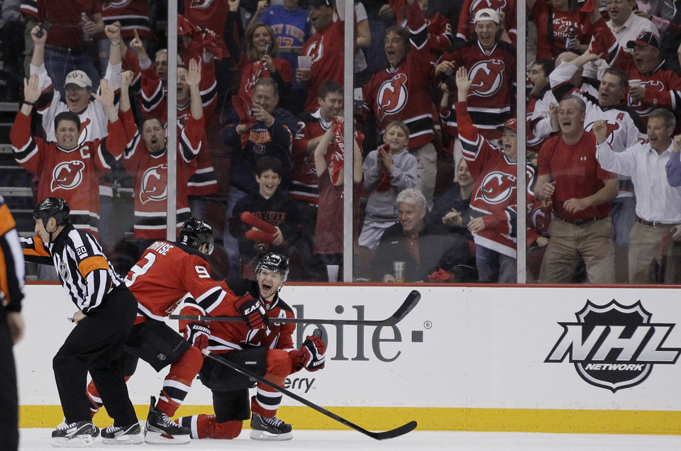 Photo -   New Jersey Devils' Patrik Elias, right, of the Czech Republic, celebrates with teammate Zach Parise (9) after scoring a goal during the first period of Game 3 of a first-round NHL hockey Stanley Cup playoff series against the Florida Panthers, Tuesday, April 17, 2012, in Newark, N.J. (AP Photo/Julio Cortez)
