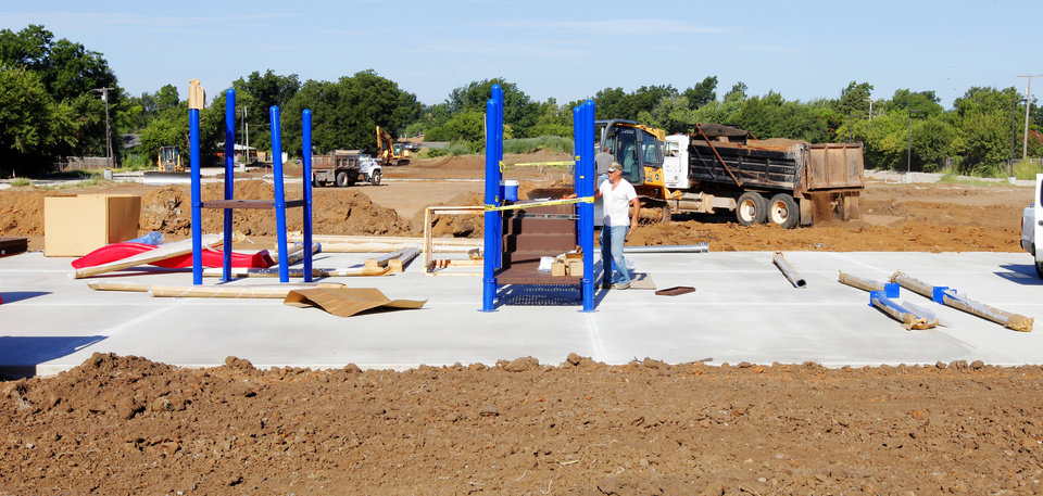 Photo -  Two playgrounds are still under construction at Arbor Grove Elementary School. Photo by Paul B. Southerland, The Oklahoman   PAUL B. SOUTHERLAND -