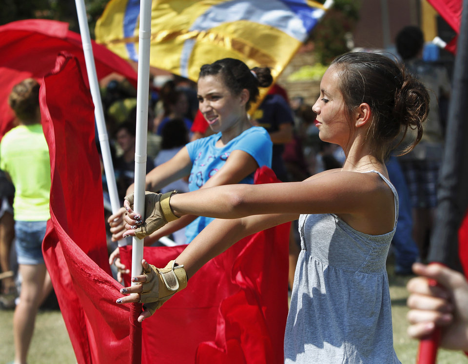 Photo - Members of the Southmoore High School Color Guard practice techniques at a clinic hosted by the UCO Color Guard as part of Band Day activities  at the state fair on Monday, Sep. 17, 2012,  Photo by Jim Beckel, The Oklahoman.