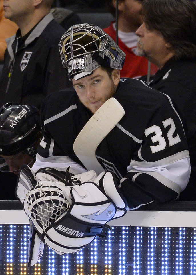 Photo - Los Angeles Kings goalie Jonathan Quick looks on from the bench after being pulled late in the game to ad an extra skater during the third period of an NHL hockey game against the Detroit Red Wings, Saturday, Jan. 11, 2014, in Los Angeles. (AP Photo/Mark J. Terrill)