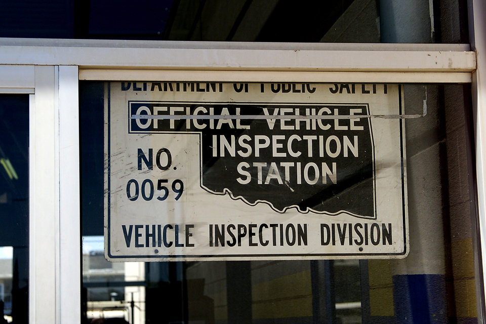 Photo - Official Vehicle (auto, car) Inspection Station sign.  Staff photo by Doug Hoke.
