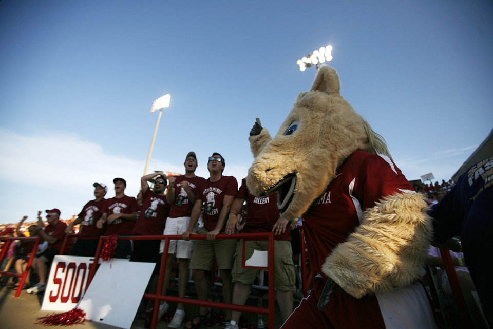 OU mascot, Sooner, leads the crowd in cheer during a Women\'s College World Series game between OU and Alabama at ASA Hall of Fame Stadium in Oklahoma City, Monday, June 4, 2012. Photo by Garett Fisbeck, The Oklahoman