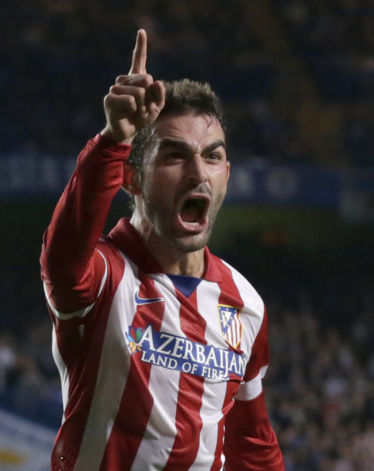 Photo - Atletico's Adrian Lopez celebrates after scoring his sides first goal of the game during the Champions League semifinal second leg soccer match between Chelsea and Atletico Madrid at Stamford Bridge stadium in London, Wednesday, April 30, 2014. (AP Photo/Matt Dunham)