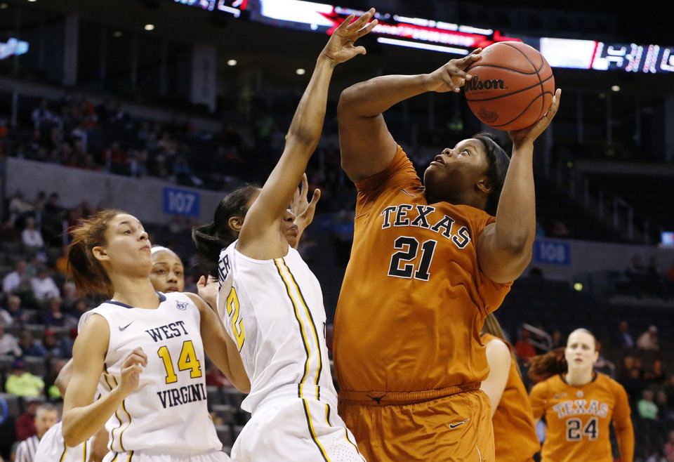Photo - Texas forward Nekia Jones (21) shoots in front of West Virginia forward Jess Harlee (14) and guard Taylor Palmer (2) in the second half of an NCAA college basketball game in the semifinals of the Big 12 Conference women's tournament in Oklahoma City, Sunday, March 9, 2014. West Virginia won 67-60. (AP Photo/Sue Ogrocki)