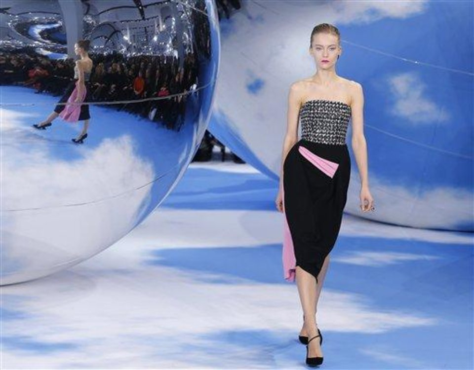 A model wears a creation by designer Raf Simons for Christian Dior\'s Ready to Wear Fall-Winter 2013-2014 fashion collection, presented, Thursday, March.1, 2013 in Paris. (AP Photo/Jacques Brinon)