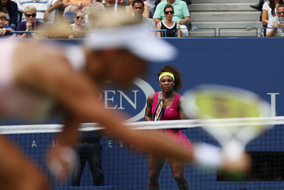 Photo -   Czech Republic's Andrea Hlavackova returns a shot to Serena Williams in the fourth round of play at the 2012 US Open tennis tournament, Monday, Sept. 3, 2012, in New York. Williams won the match. (AP Photo/Julio Cortez)