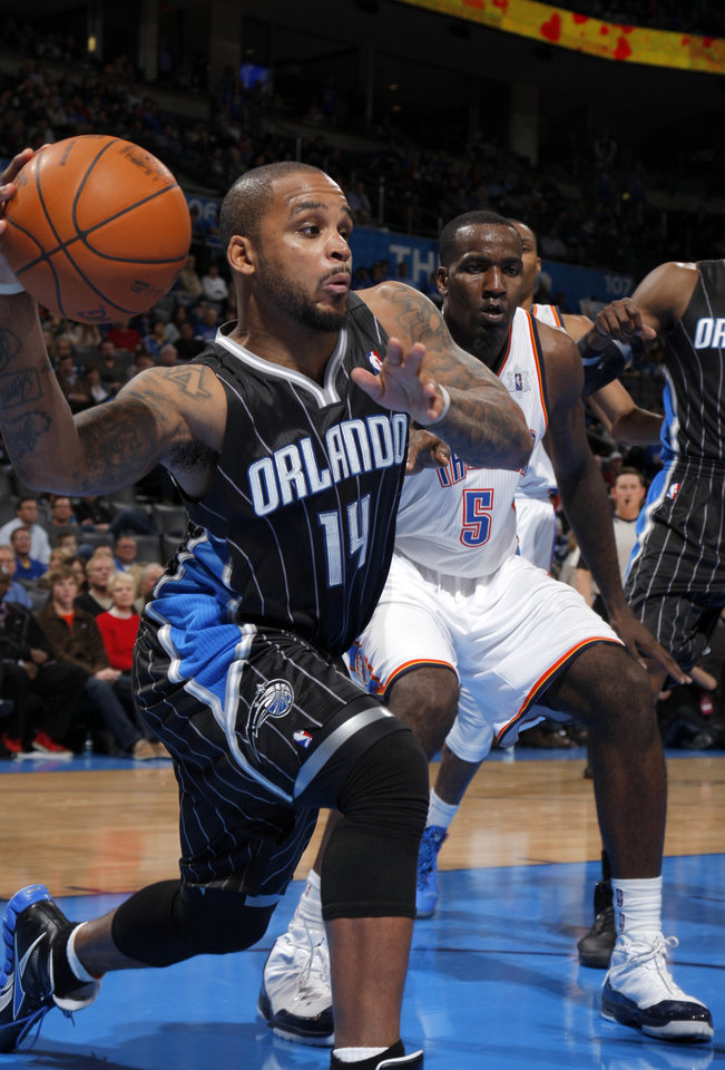 Orlando Magic's Jameer Nelson looks to pass the ball during the opening day NBA basketball game between the Oklahoma CIty Thunder and the Orlando Magic at Chesapeake Energy Arena in Oklahoma City, Sunday, Dec. 25, 2011. Photo by Sarah Phipps, The Oklahoman