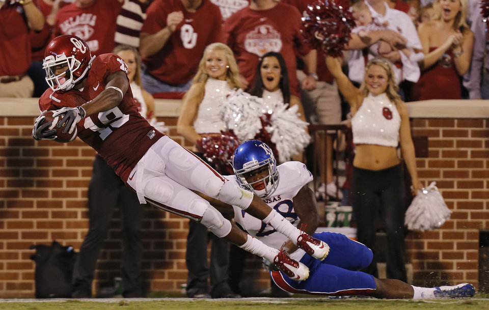 KU's Brandon Hawks (28) can't stop OU's Justin Brown (19) from scoring a touchdown during the college football game between the University of Oklahoma Sooners (OU) and the University of Kansas Jayhawks (KU) at Gaylord Family-Oklahoma Memorial Stadium on Saturday, Oct. 20th, 2012, in Norman, Okla. Photo by Chris Landsberger, The Oklahoman