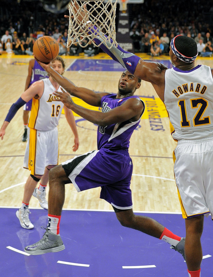 Sacramento Kings guard Tyreke Evans, center, puts up a shot as Los Angeles Lakers center Dwight Howard, right, defends and forward Pau Gasol of Spain, looks on during the first half of their NBA basketball game, Sunday, Nov. 11, 2012, in Los Angeles. (AP Photo/Mark J. Terrill)