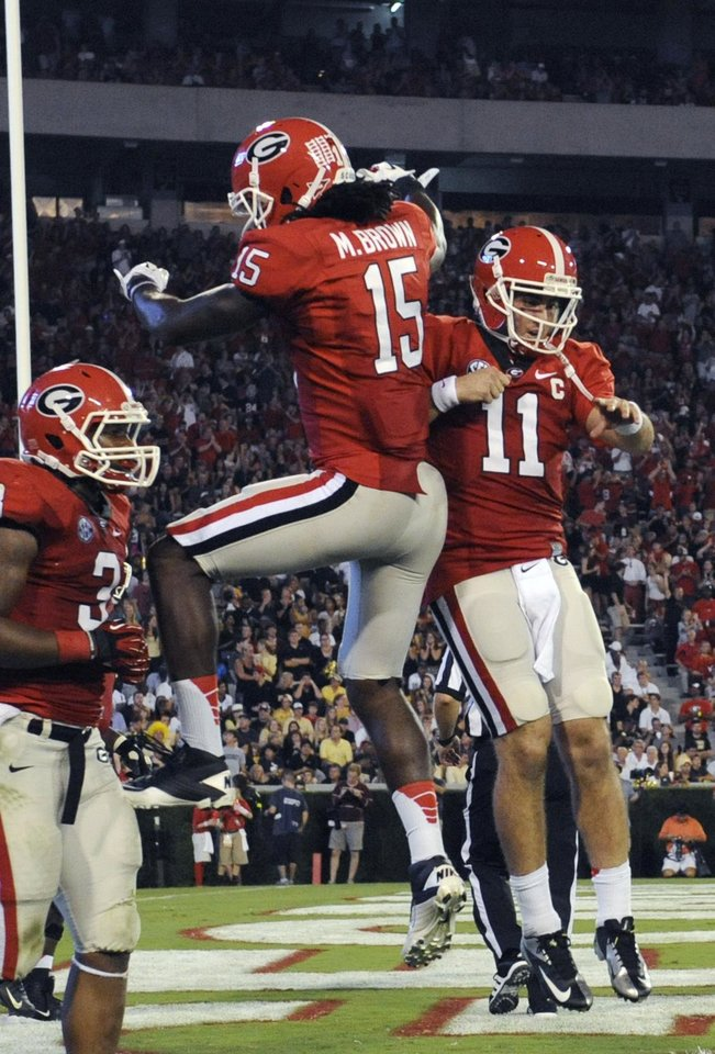 Photo -   Georgia wide receiver Marlon Brown (15) quarterback Aaron Murray (11) celebrate a during the third quarter of an NCAA college football game against Vanderbilt , Saturday, Sept. 22, 2012, in Athens, Ga. Georgia won 48-3. (AP photo/John Amis)