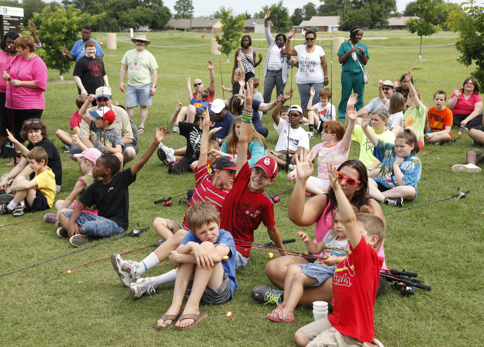 Photo -  Children and their parents participate in the Oklahoma City Parks and Recreation Hooked on Fishing event. Photo by Paul Hellstern, The Oklahoman   PAUL HELLSTERN -