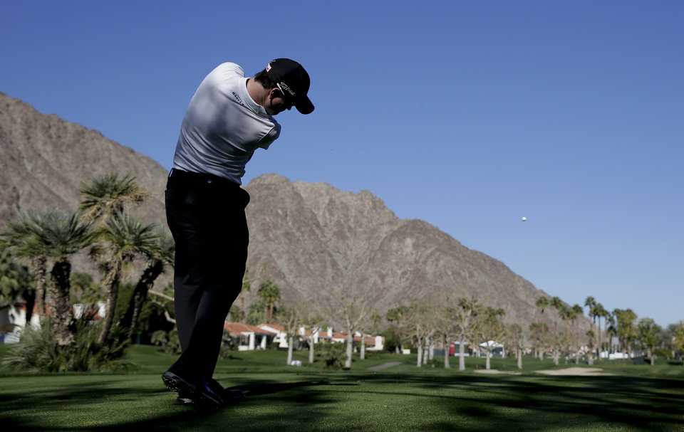 Photo - Zach Johnson hits from the 12th tee during a practice round for the Humana Challenge golf tournament on the Palmer Private course at PGA West, Wednesday, Jan. 15, 2014, in La Quinta, Calif. (AP Photo/Chris Carlson)
