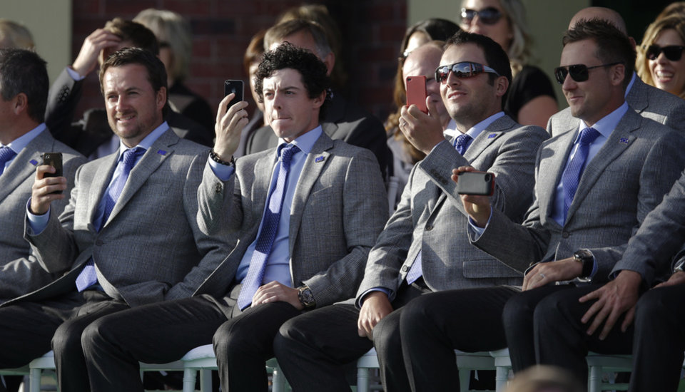 Photo -   Europe's Graeme McDowell, left, Rory McIlroy, Francesco Molinari and Ian Poulter take pictures during the opening ceremony at the Ryder Cup PGA golf tournament Thursday, Sept. 27, 2012, at the Medinah Country Club in Medinah, Ill. (AP Photo/David J. Phillip)
