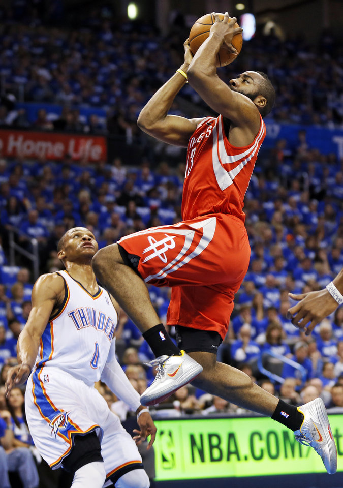 Houston's James Harden (13) drives to the basket past Oklahoma City's Russell Westbrook (0) during Game 1 in the first round of the NBA playoffs between the Oklahoma City Thunder and the Houston Rockets at Chesapeake Energy Arena in Oklahoma City, Sunday, April 21, 2013. Photo by Nate Billings, The Oklahoman