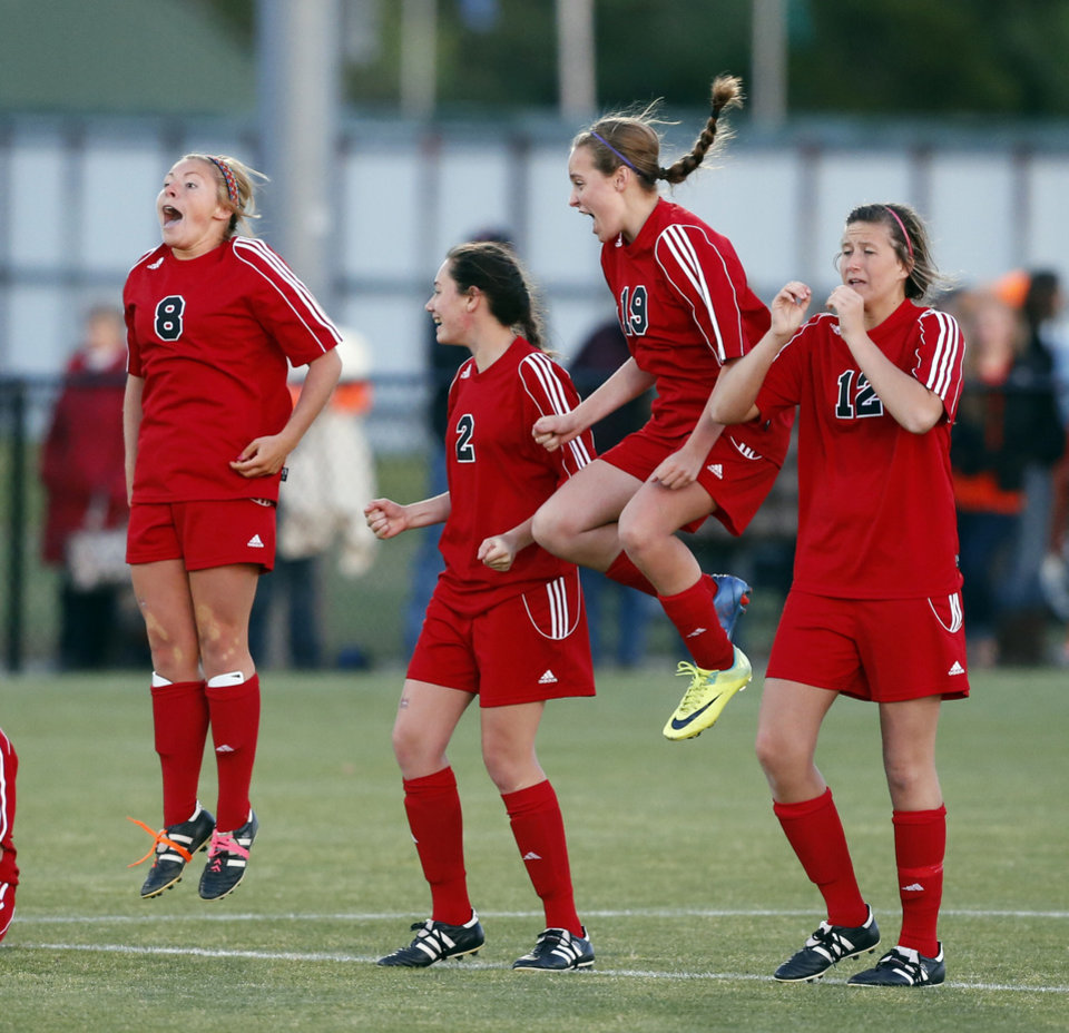 Mustang players Shelbi Kuykendall (8), Marilyn Kalin (2), Alina Magruder (19), and Taylor Moseley (12) react to goalie Brandi Hutchison's  winning stop in overtime in girls soccer playoff quarterfinal action between Mustang and Norman North at Norman North High School on Friday, May 3, 2013, in Norman, Okla.   Photo by Steve Sisney, The Oklahoman