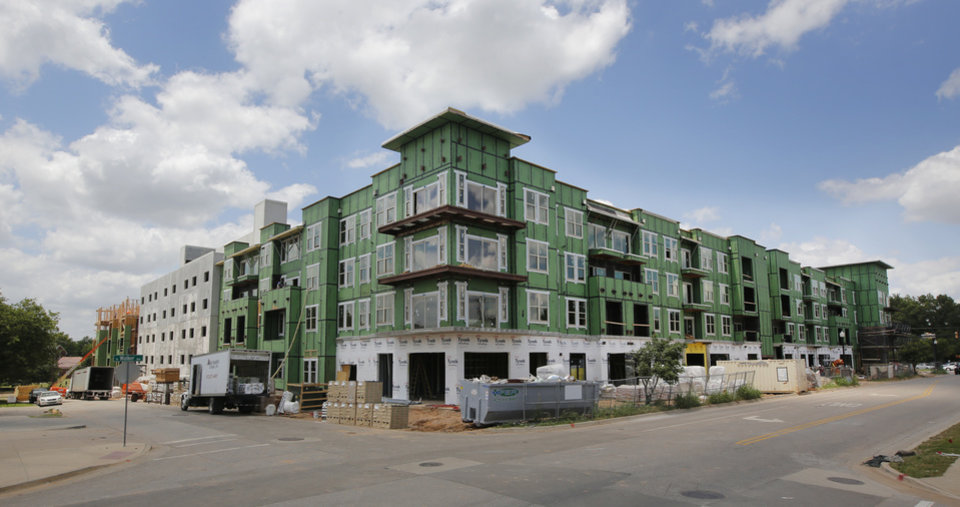 Photo -  Construction continues on The Edge apartments at NW 13 and Walker. Photo by Steve Gooch, The Oklahoman   Steve Gooch -  The Oklahoman