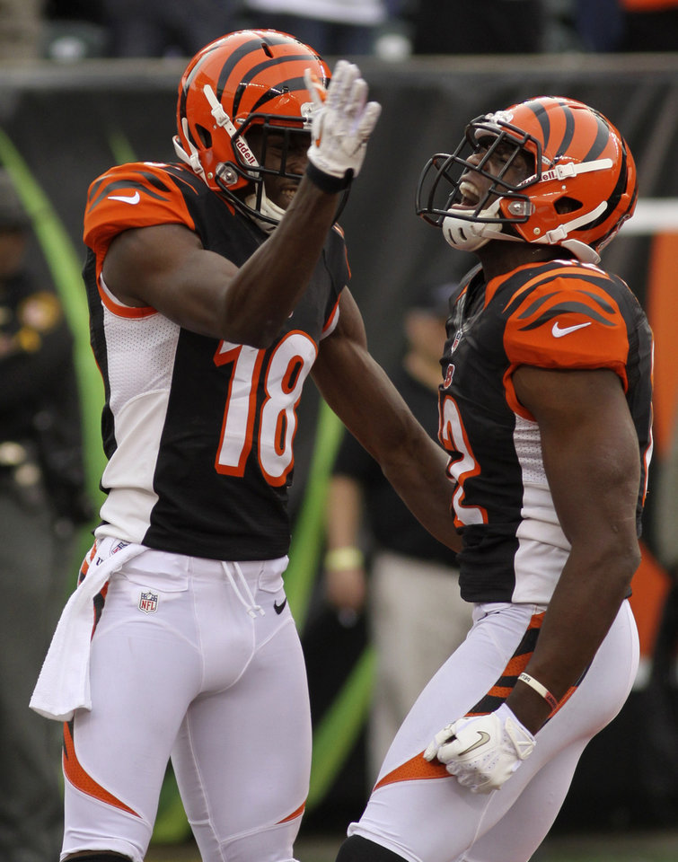 Photo -   Cincinnati Bengals wide receiver Mohamed Sanu (12) celebrates with wide receiver A.J. Green (18) after catching a 10-yard touchdown pass against the New York Giants in the second half of an NFL football game on Sunday, Nov. 11, 2012, in Cincinnati. (AP Photo/Tom Uhlman)