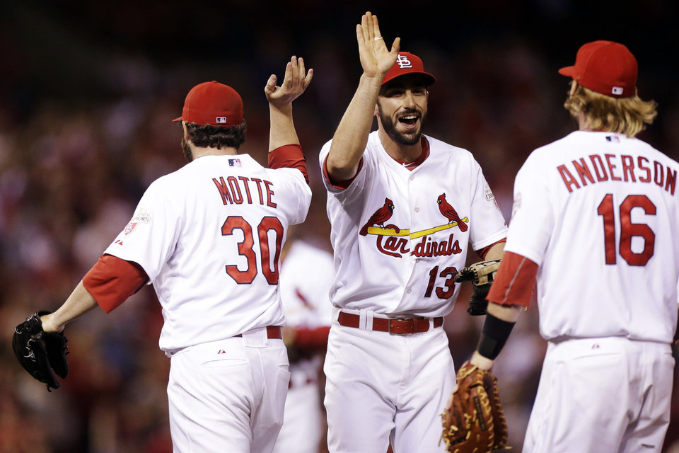 Photo -   St. Louis Cardinals third baseman Matt Carpenter, center, celebrates with closer Jason Motte and first baseman Bryan Anderson against the Cincinnati Reds after the final out of their baseball game, Wednesday, Oct. 3, 2012, in St. Louis. The Cardinals won 1-0. (AP Photo/St. Louis Post-Dispatch, Chris Lee) EDWARDSVILLE INTELLIGENCER OUT; THE ALTON TELEGRAPH OUT