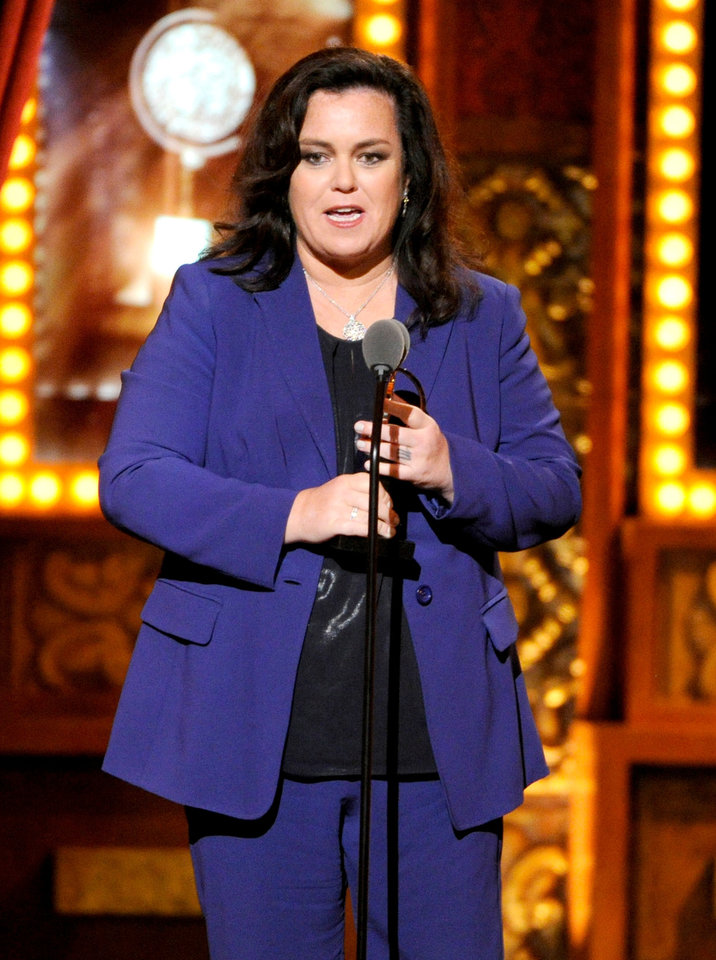 Photo - Rosie O'Donnell accepts the Isabelle Stevenson Award on stage at the 68th annual Tony Awards at Radio City Music Hall on Sunday, June 8, 2014, in New York. (Photo by Evan Agostini/Invision/AP)