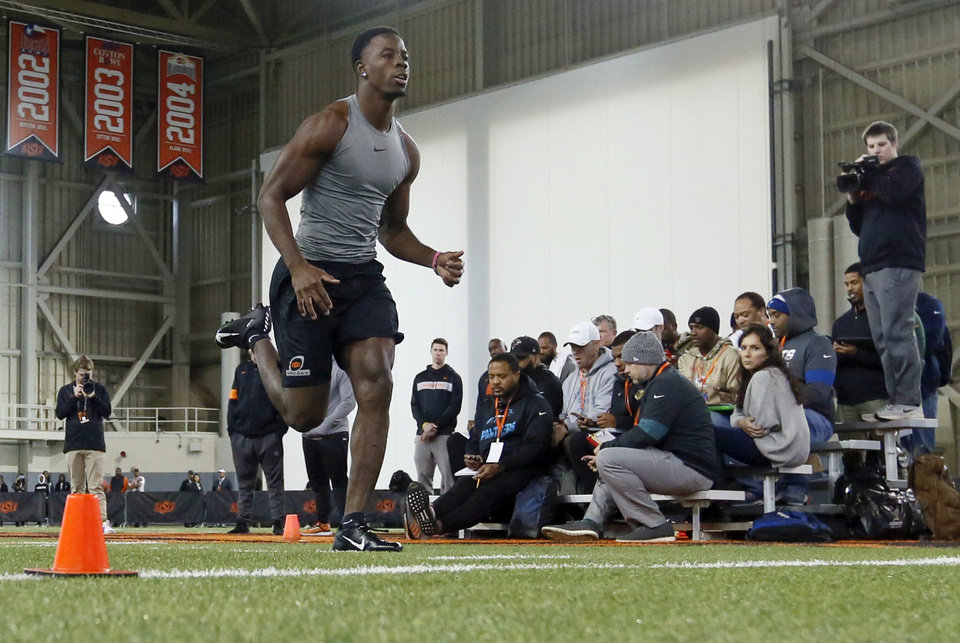 Photo - Oklahoma State cornerback A.J. Green runs a shuttle run during OSU Pro Day inside the Sherman E. Smith Training Center in Stillwater, Okla., Tuesday, March 10, 2020. [Nate Billings/The Oklahoman]