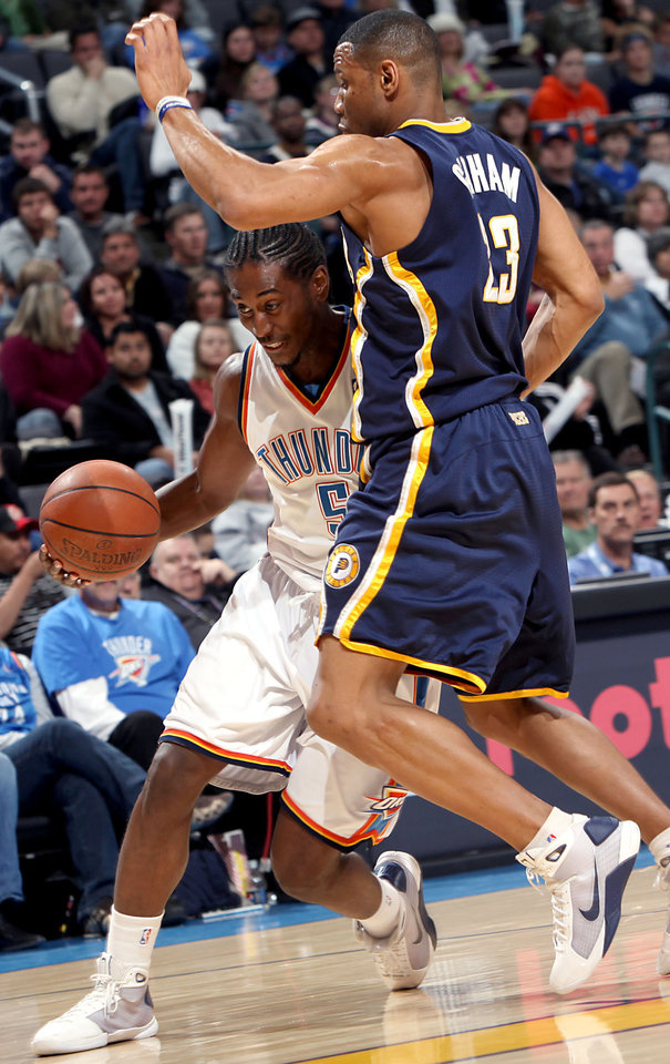 Photo - Oklahoma City's Kyle Weaver runs into pressure from Indiana's Stephen Graham during the NBA basketball game between the Indiana Pacers and the Oklahoma City Thunder at the Ford Center in Oklahoma City, Sunday, April 5, 2009. The Thunder lost 117 to 99. Photo by John Clanton, The Oklahoman