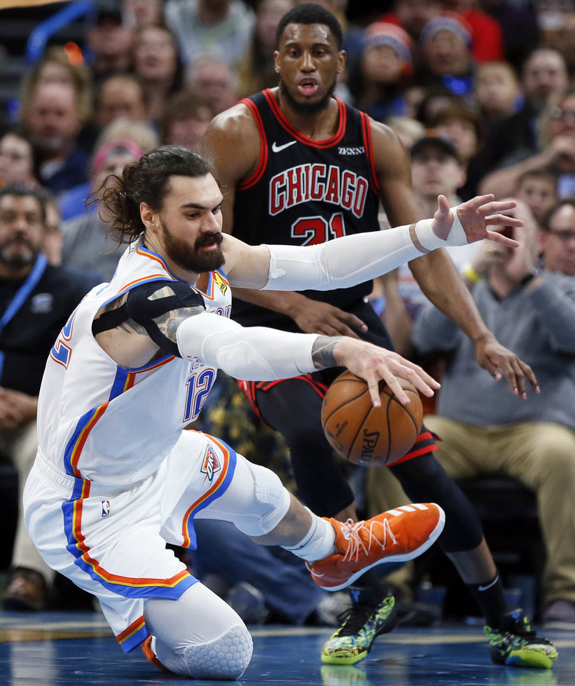 Photo - Oklahoma City's Steven Adams (12) chases the ball in front of Chicago's Thaddeus Young (21) in the third quarter during an NBA basketball game between the Oklahoma City Thunder and Chicago Bulls at Chesapeake Energy Arena in Oklahoma City, Monday, Dec. 16, 2019. Oklahoma City won 109-106. [Nate Billings/The Oklahoman]