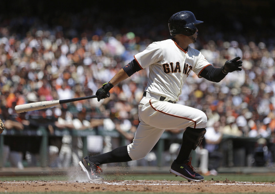 Photo - San Francisco Giants' Gregor Blanco swings for an RBI single off Pittsburgh Pirates' Charlie Morton in the first inning of a baseball game Wednesday, July 30, 2014, in San Francisco. (AP Photo/Ben Margot)