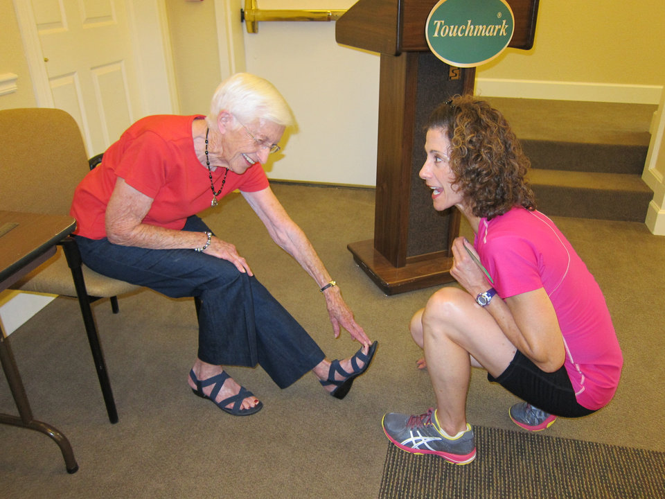 Dorothy Rupe gets help from Diane Folk, right, during Touchmark at Coffee Creek\'s Senior Fitness Testing, open to the public during Active Aging Week recently.