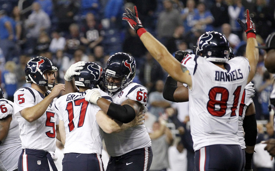 Photo -   Houston Texans kicker Shayne Graham (17) is congratulated by Donnie Jones (5) and Ryan Harris (68) after kicking the game-winning field goal in overtime of an NFL football game against the Detroit Lions at Ford Field in Detroit, Thursday, Nov. 22, 2012. The Texans won 34-31. At right celebrating is Texans' Owen Daniels. (AP Photo/Rick Osentoski)
