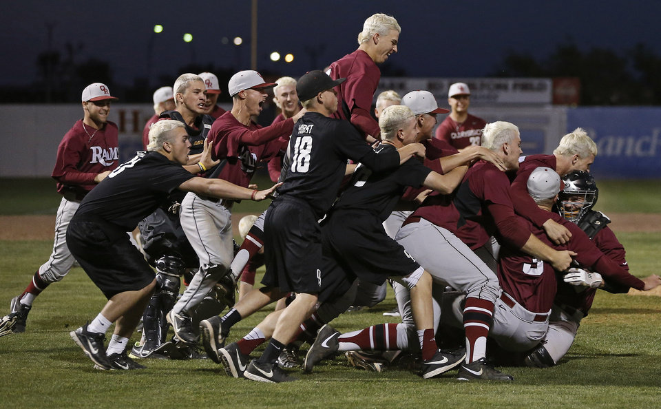 Photo - Owasso celebrates beating Norman North in the Class 6A state baseball tournament championship game in Shawnee, Okla., Saturday, May 11, 2013. Photo by Bryan Terry, The Oklahoman