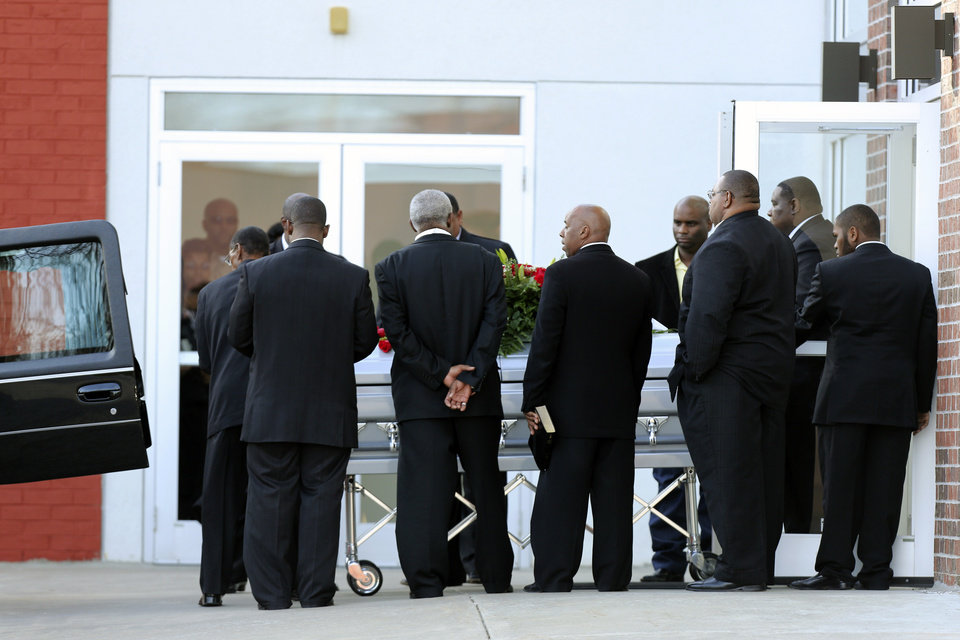Photo - A coffin with the body of Kansas City Chiefs' Jovan Belcher is placed in a hearse after a service at the Landmark International Deliverance and Worship Center, Wednesday, Dec. 5, 2012, in Kansas City, Mo. Belcher shot his girlfriend, Kasandra Perkins, at their home Saturday morning before driving to Arrowhead Stadium and turning the gun on himself. (AP Photo/Ed Zurga)
