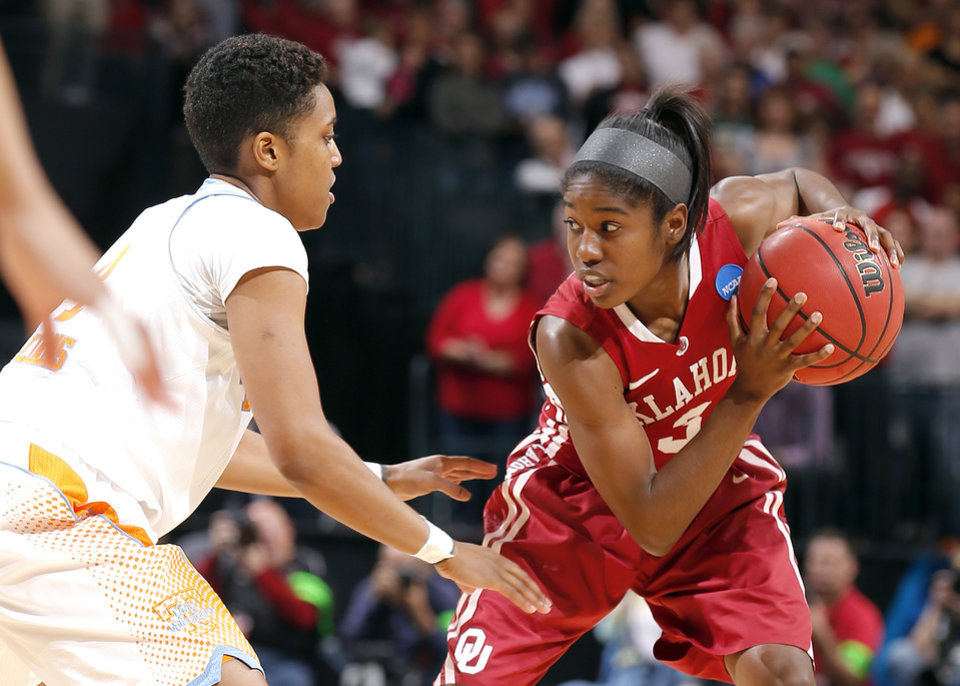 Photo - Oklahoma's Aaryn Ellenberg (3) tries to get around Tennessee's Kamiko Williams (4) during college basketball game between the University of Oklahoma and the University of Tennessee at the  Oklahoma City Regional for the NCAA women's college basketball tournament at Chesapeake Energy Arena in Oklahoma City, Sunday, March 31, 2013. Photo by Sarah Phipps, The Oklahoman