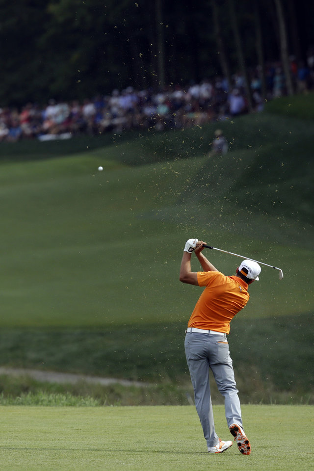 Photo - Rickie Fowler hits from the fairway on the sixth hole during the final round of the PGA Championship golf tournament at Valhalla Golf Club on Sunday, Aug. 10, 2014, in Louisville, Ky. (AP Photo/John Locher)