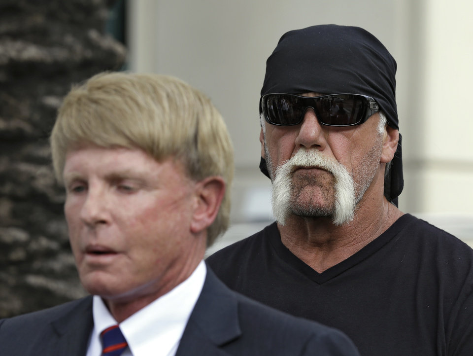Photo -   Reality TV star and former pro wrestler Hulk Hogan, whose real name is Terry Bollea, looks on as his attorney David Houston speaks during a news conference Monday, Oct. 15, 2012 at the United States Courthouse in Tampa, Fla. Hogan says he was secretly taped six years ago having sex with the ex-wife of DJ Bubba