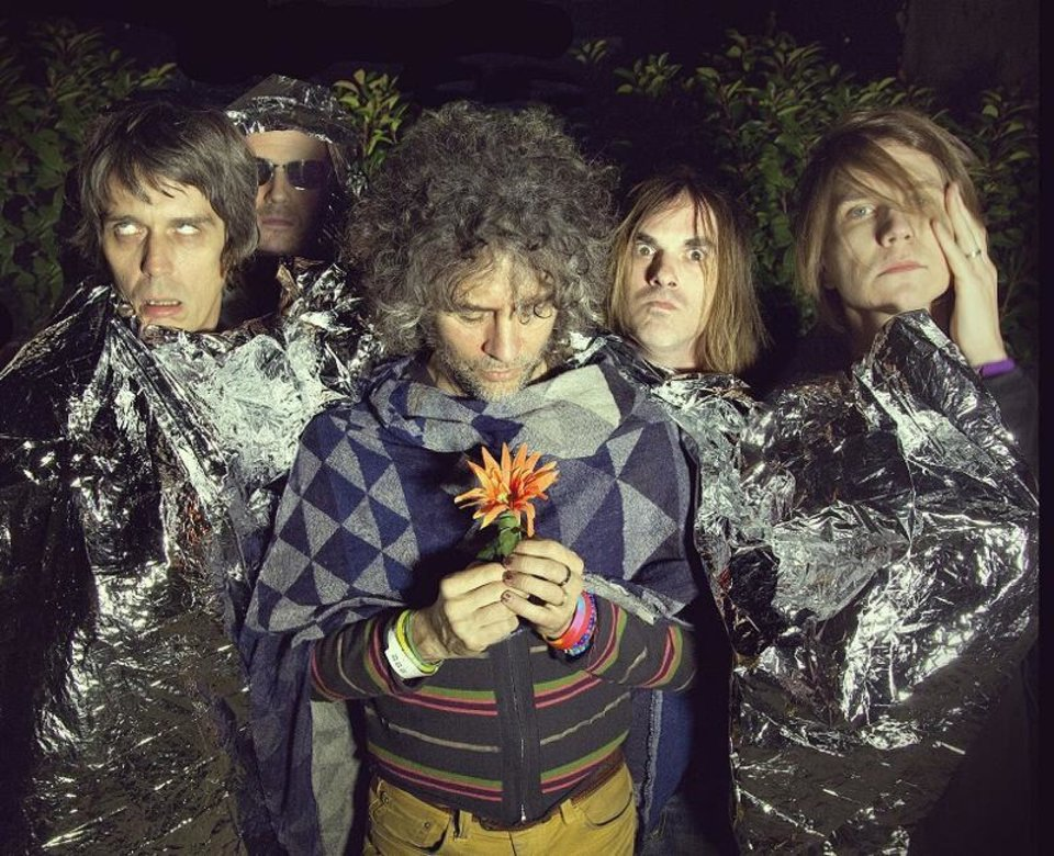 The Flaming Lips, from left: Steven Drozd, Michael Ivins, Wayne Coyne, Kliph Scurlock, Derek Brown. PHOTO PROVIDED <strong></strong>
