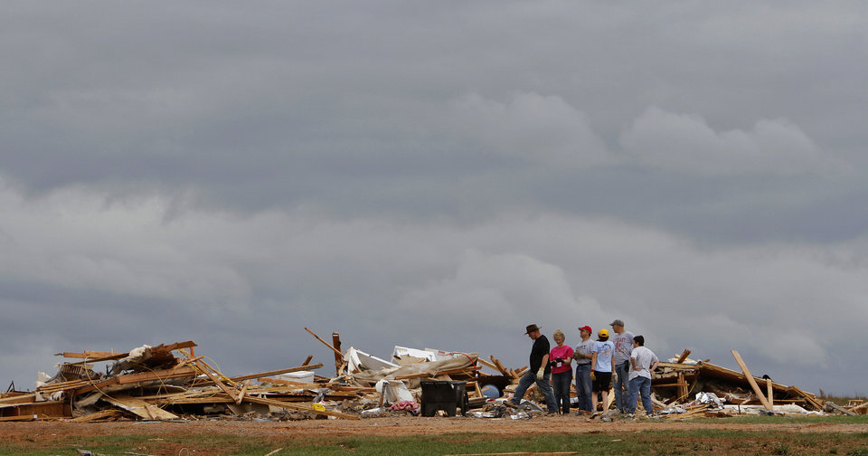 Friends and family start the search through what is left of the home owned by Jesse and Miranda Lewis west of El Reno, Wednesday, May 25, 2011. Photo by Chris Landsberger, The Oklahoman