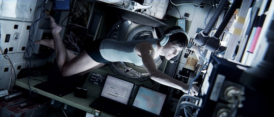 "Photo - This publicity photo released by Warner Bros. Pictures shows Sandra Bullock, left, as Dr. Ryan Stone in Â""Gravity."" (AP Photo/Courtesy Warner Bros. Pictures)"