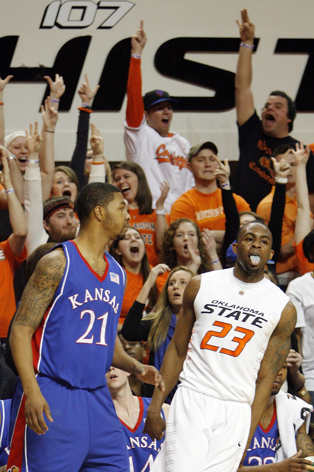 Photo - OSU fans react after James Anderson (23) made a three-point shot over Markieff Morris (21) of KU in the first half during the men's college basketball game between the University of Kansas (KU) and Oklahoma State University (OSU) at Gallagher-Iba Arena in Stillwater, Okla., Saturday, Feb. 27, 2010. Photo by Nate Billings, The Oklahoman