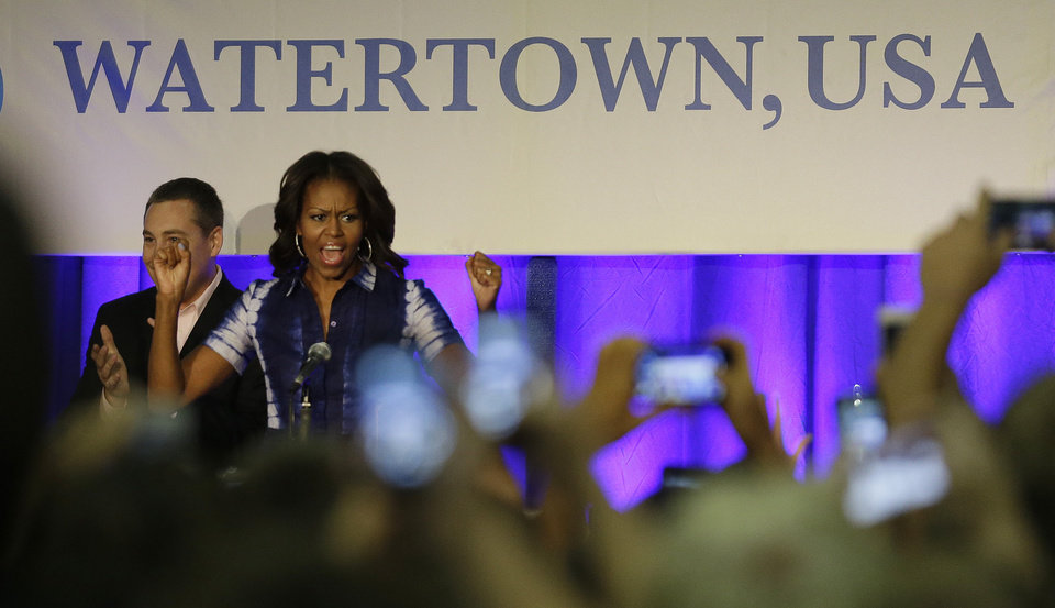 Photo - First Lady Michelle Obama participates in an event at Watertown High School to encourage people to drink more water, Thursday, Sept. 12, 2013, in Watertown, Wis. (AP Photo/Morry Gash)