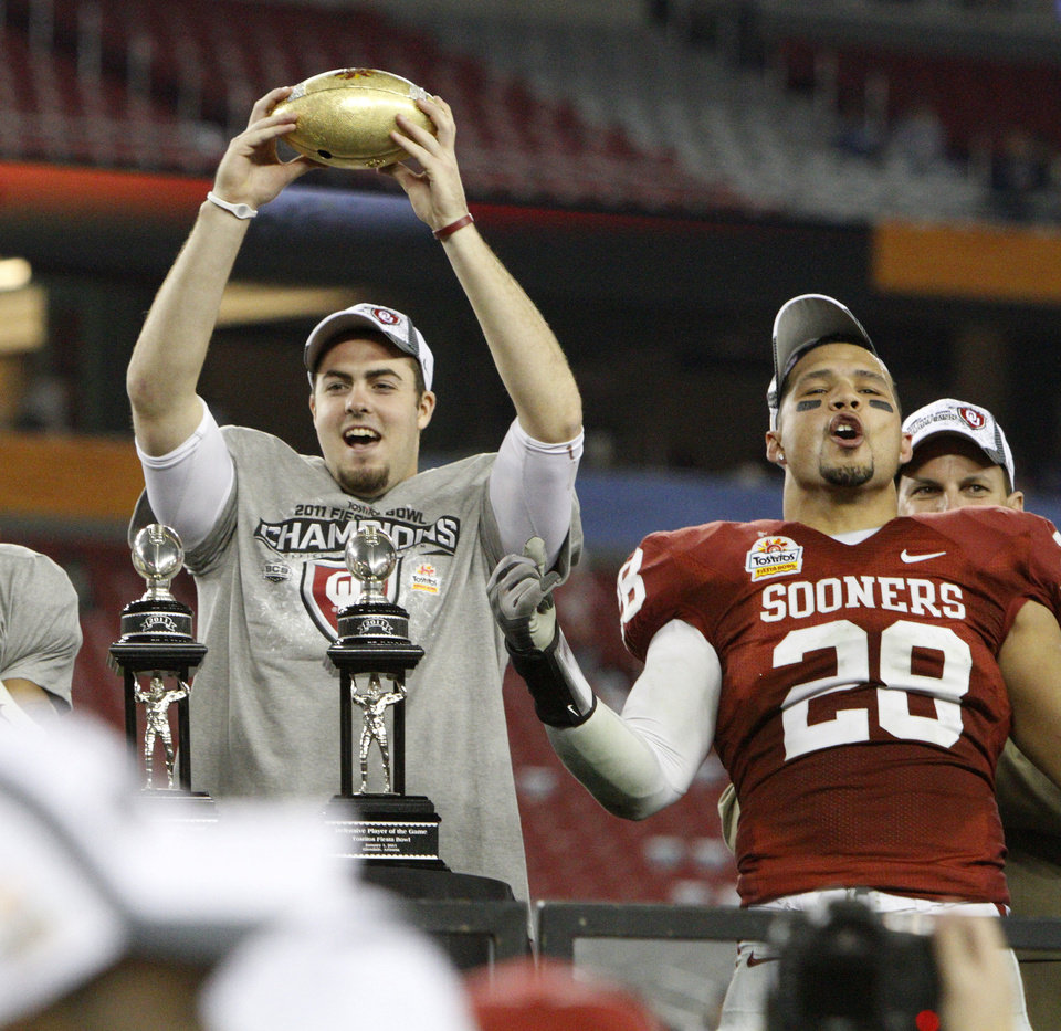 Photo - Oklahoma's Landry Jones (12) and Oklahoma's Travis Lewis (28) celebrate after the Fiesta Bowl college football game between the University of Oklahoma Sooners and the University of Connecticut Huskies in Glendale, Ariz., at the University of Phoenix Stadium on Saturday, Jan. 1, 2011.  Photo by Bryan Terry, The Oklahoman